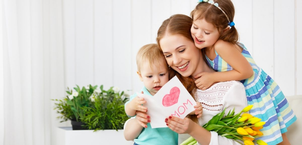 """Country Harvest 6 ways to take some """"Me Time"""" this Mother's Day image of two young children hugging mother holding mother's day card"""