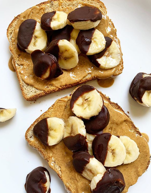 close us shot of two slices of Country Harvest Ancient Grain slices, spread with peanut butter and topped with dark chocolate dipped banana slices